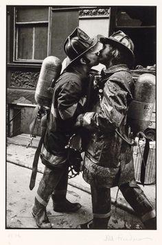 Who says love isn't macho? Jill Freedman, Firemen Kissing. Image courtesy of Swann Galleries.
