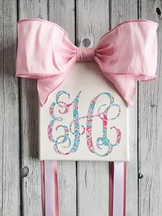 Monogrammed Hair Bow Holder with Lilly Pulitzer inspired vinyl monogram by BellesandBullfrogs on Etsy https://www.etsy.com/listing/248668663/monogrammed-hair-bow-holder-with-lilly