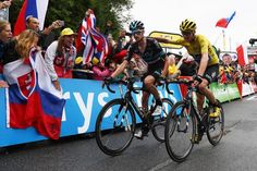 Chris Froome finishes stage 19 with Wout Poels, thanking Poels for his help after Froome's crash. Froome had to complete the final climb on Geraint Thomas' bike after his was too badly damaged.