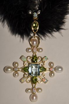 One of a kind pendant in 18k yellow gold with aquqmarin, peridots, pearls and opals created by Daniela and Adrian Popa for Bon Ton Joyaux. http://bontonjoyaux.ro/bijuterii/medalioane/ https://www.facebook.com/photo.php?fbid=101247356611796&set=a.101243989945466.1636.100001795956015&type=3&theater