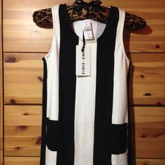 BNWT Striped dress from LF Brand new with tags attached, never worn. Straight fit LF Dresses