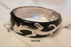 wonderful selection available in my Ruby lane shop. For vintage to now visit my Ruby Plaza shop 10% off store wide memorial day sale on now till 5/28 at midnight. each shop links found on home pages.  Fantastic Crown Trifari raised double dragons black enamel bangle Bracelet