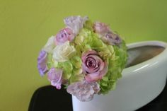 Green hydrangea, lavender roses and lavender lisianthus bridesmaid's bouquets by Beautiful Blooms by Jen.