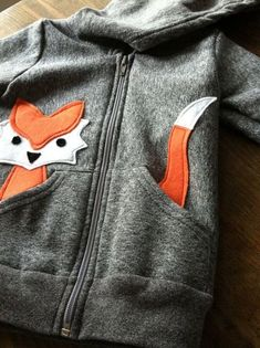 Uses a die cut on a kids hoodie. So cute-could use those cute sizzix animals for this.