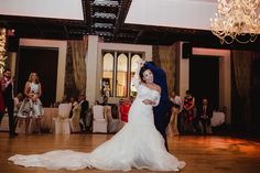 Long white wedding dress on the dance floor. Remember the fun of your own wedding by having pictures taken by Dublin-based wedding photographer Olga Hogan.
