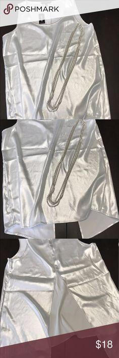 Express Shiny White Sleeveless Blouse Size Medium NWT!  Express White Blouse with Shimmer Sparkle.  Size Medium.  Open V Slit up the back. Express Tops Blouses