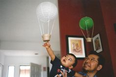 toddler with grandfather touches balloon photo