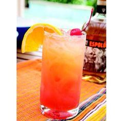 Tequila Sunrise | 1 1/2 oz. (45ml) Tequila Top with Orange Juice Splash of Grenadine Lime Garnish