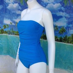 NEW TOMMY BAHAMA full swimsuit swim blue 10 Gathered sides, tummy control and a padded shelf bra make this full suit figure flattering! New with tags and hygiene strip in place, this one has loops for a halter strap that is missing. Your favorite one can easily replace; however, it's currently strapless. 80% nylon; 20% spandex. Size 10. Retail $108. Relax by Tommy BAHAMA. Peacock blue. Tommy Bahama Swim One Pieces