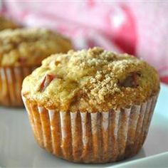 Aunt Norma's Rhubarb Muffins Recipe Breads with flour, baking soda, baking powder, salt, brown sugar, vegetable oil, eggs, vanilla extract, buttermilk, rhubarb, chopped walnuts, melted butter, white sugar, ground cinnamon
