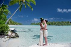 Taha'a, French Polynesia beach drone destination lesbian wedding with tropical elements and two brides | Equally Wed, the world's leading LGBTQ wedding resource   lei, flower crown, outdoors, real weddings, lesbian, LGBT, LGBTQ, same-sex wedding, ceremony, unique ideas, travel, inspiration
