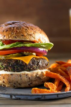 These simple veggie burgers – just mushrooms, beans, garlic, oats, spices and soy sauce – come together in a snap. They're so hearty, even meatlovers will devour them. (Photo: Michael Kraus for The New York Times)