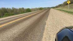 Swarms of tent caterpillars cover a road in Canada.