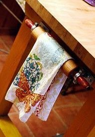 Old Vintage Rolling Pin...re-purposed into a towel bar. Would be a great way to incorporate Gram's rolling pin into the kitchen decor