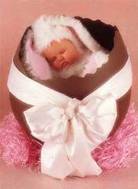 Baby easter bunny asleep in a chocolate egg