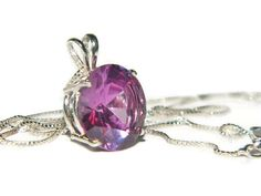 This necklace is so beautiful! 13mm Round stone cut stone. Color changing Lab Created Alexandrite. Turns from a purplish color to a bluish