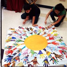 Handprint suns--This would make a cute banner to hang in Cardinal Lodge.