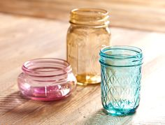 Tint the glass. Mix one part water, two parts decoupage glue and several drops of food blue, red or green food coloring. Paint the mixture on the jar and allow to dry.