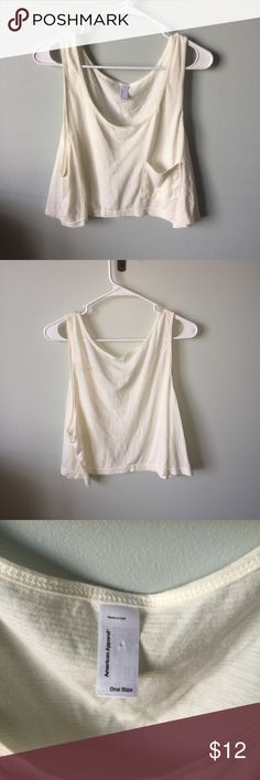 Cream Crop Top cream top with a oversized pocket and cut out sides only worn twice American Apparel Tops Crop Tops