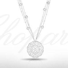 Admire this delicate diamond necklace from our 2014 Red Carpet Collection. The pendant of fine diamond-set lace design within an undulating diamond surround, to the similarly set fine link chain.