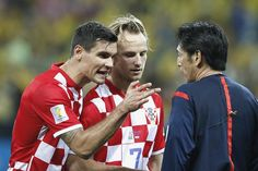 Dejan Lovren believes Fifa should hand the World Cup trophy to Brazil now if referees are going to favour the host nation as the Croatia defender called for the Japanese official at the centre of a cheat storm to be banned. Brazil overcame Croatia 3-1 in the tournament's opening match at the Arena Corinthians in Sao Paulo last night thanks in part to Yuichi Nishimura's decision to award a penalty for a flagrant dive by Fred.