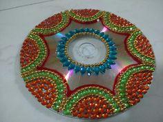 Useless CD decorated  to keep diya in diwali