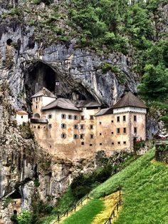 Predjama Castle in Slovenia Slovenia's third amazing cave has a gaping mouth so enormous that a castle is embedded in it! The invincible and surreal Predjama Castle is straight out of one of Tolkien's visions. A medieval Robin Hood, Erazem Lueger, used this fantasy fortress as his hideout. When Austrian soldiers laid siege for months, he tossed fresh cherries and flowers on them to prove that he had a secret magical portal that let him come and go at will.