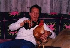 This guy giving his rooster a swig. | The 49 Most WTF Pictures Of People Posing With Animals