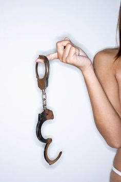 PLaY Time!  Google Image Result for http://www.blogcdn.com/main.stylelist.com/media/2010/08/woman-in-underwear-holding-handcuffs-240bes082010.jpg