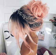 Pink peach hair color in dark roots made in a messy bun girdled with tiny flower crown | Wedding Hairstyle for brides