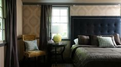 love the mix of patterns, (he also used a lower bed frame with a high headboard)