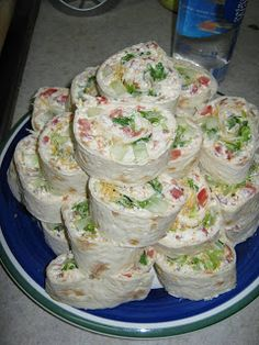 BLT ROLL UPS Whipped Cream Cheese 3 to 4 Tablespoons Mayo Tomato Diced Bacon Crumbled Deseeded Cucumber diced Romaine Lettuce Finely Shredded Cheddar or Jack Cheese Tortillas