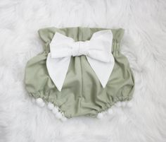 These are the most adorable bloomers for babies and toddlers. Made from 100% cotton. These bloomers have an adorable bow on the bum and poms lining the inside of the legs. Please visit our FAQ page for current production and ship times. These fit true to size, but you can visit our FAQ page for size charts based on weight.
