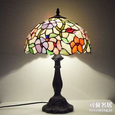 It may seem kind of old-ladyish, but I just love really colorful stained-glass domed lamps. (Tiffany Lamp)