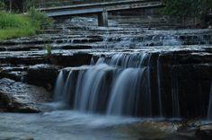 Smaller waterfall with bridge