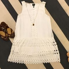 Beautiful white embroidery dress.  Size small. Garcia white dress.  Size small.  65% cotton 35% silk.  The lining is 100% cotton.  Hand wash cold or gentle cycle with similar colors.  The dress falls mid thigh (I'm 5'9) but the lining sits like a mini. Gracia Dresses Midi