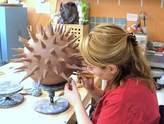 Constructing one of the 'pollens' in my Dublin studio. Award winning ceramic outdoor water sculpture by Michelle Maher - Pollen Hotspot. The pollen were hand sculpted in my own grogged paper clay body and high fired in an electric kiln to 1260°C (Cone 8).The piece is inspired by microscopic pollen grains - measured in nanometers these tiny grains are perhaps natures greatest sculptures. www.ceramicforms.com