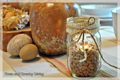 Filled mason jars halfway with pinto beans and burlap!
