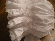 smocked bonnet white with pink flowers, lace edging. $30 https://smockedbeauties.etsy.com/