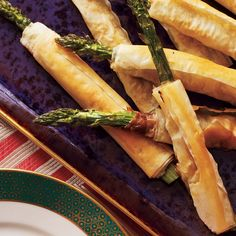 Phyllo-Wrapped Asparagus with Prosciutto | Phyllo-Wrapped Asparagus with Prosciutto is an appetizer worthy of a special occasion. Simply roll up prosciutto and asparagus in phyllo dough and bake. The results are a crunchy, easy appetizer all will enjoy. You can also chop the prosciutto and sprinkle it on the phyllo.