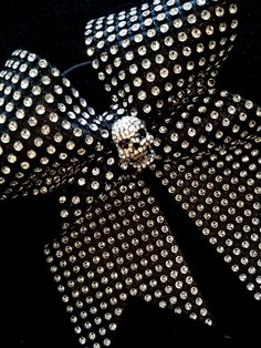 Black & Silver Rhinestone Skull Cheer Bow You will definitely turn heads with this one! Shiny lack fabric adhered to sparkling rhinestones with a Cheer Bows, Skull And Bones, Silver Rhinestone, Skull Art, How To Make Bows, Skulls, Competitive Cheerleading, Black Silver, Hair Clips