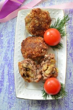 Baked cutlets with mushrooms and cheese