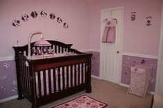 "Baby Girl Sugar Plum Butterfly Nursery, Baby girl butterfly nursery in butterflies with lavender lilac and pink color. The color below the chair rail is ""Glass Slippers-1003-8A"" and the color above the rail is ""Lilac Lace-1003-8C"". The butterflies are painted in these two color as well as ""Plump Grape-1003-7A"" The paint is Valspar which I think is only available at Lowes. , Nurseries Design"