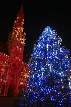 The changing colors of the Grand Place Christmas Market - Brussels, Belgium
