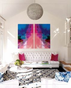 Minimalist Living Room With Colorful Art And Pillows