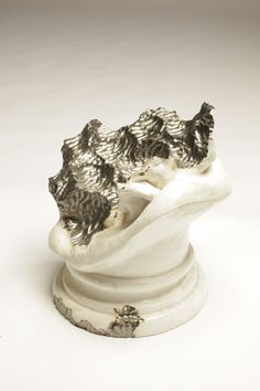 Olaf Brzeski-Sculpture eaten by snail