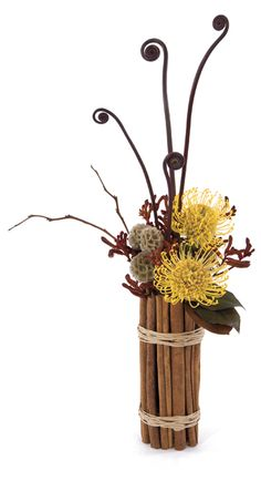 I love this exotic collection! Click to watch how to make the cinnamon stick cover.  Florists' Review Magazine® > August 2012 > Technique