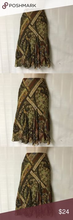 Ralph Lauren Pattern Silk Skirt Size Medium This silk skirt is so pretty and feminine! It has a great pattern and gorgeous colors. The skirt has a scalloped and ruffled hem. It zips up the back and has a great fit. Sorry no trades. Ralph Lauren Skirts