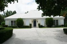 Lowest price home in exclusive Seminole Landing community. A wonderful courtyard pool home with two room studio on a beautiful one acre home site. For more information about this property click here: http://idx.waterpointerealty.com/idx/details/homes/c006/RX-9979938/12407-Ridge-Road-North-Palm-Beach-FL-33408