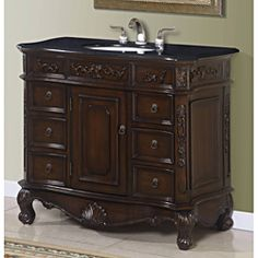 @Overstock - This single sink bathroom vanity cabinet features a beautiful granite top and ogee/beveled edges. The center door opens to a shelf, with six small drawers on the side and a top felted drawer (left and right).http://www.overstock.com/Home-Garden/Isidora-Single-Bathroom-Vanity-Cabinet-with-Granite-Top/7008837/product.html?CID=214117 $779.99